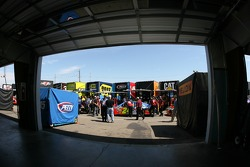 Empty garage as the cars line up for tech inspection