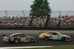 David Gilliland spins again in front of P.J. Jones
