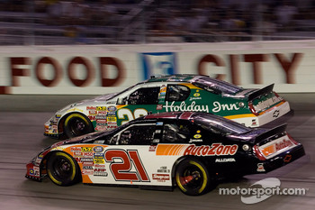 Scott Wimmer and Jeff Burton race down the backstretch