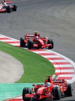 Felipe Massa, Scuderia Ferrari, F2007 leads Kimi Raikkonen, Scuderia Ferrari, F2007 and Lewis Hamilton, McLaren Mercedes, MP4-22