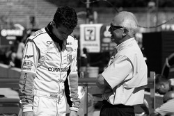 Oliver Gavin and Corvette Racing team members discuss after a pitstop practice