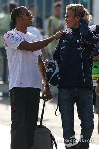 Lewis Hamilton, McLaren Mercedes checks out Nico Rosberg, WilliamsF1 Team hair