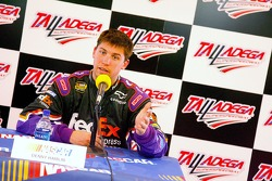 Denny Hamlin speaks with the media