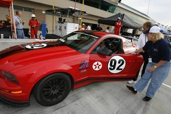 Mario Andretti after driving a Ford Mustang around Miller Motorsports Park