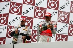 Podium: champagne for Lewis Hamilton and Heikki Kovalainen