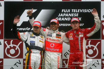 Podium: race winner Lewis Hamilton with Heikki Kovalainen and Kimi Raikkonen