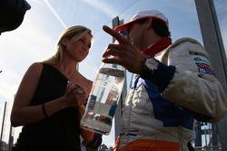 Dutch Singer 'Do' talking with Jeroen Bleekemolen, driver of A1 Team Netherlands