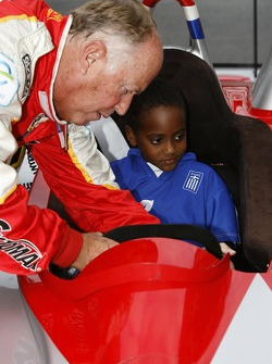 Petit Preview Party at Atlantic Station: Greg Pickett adjusts the seat and steering wheel for a young fan