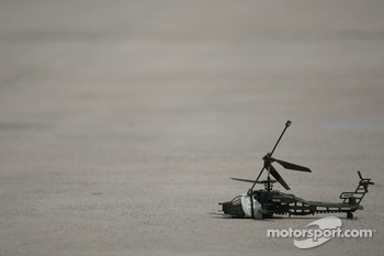 The remote control helicopter crashed in the paddock