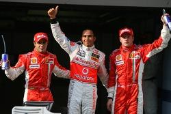 3rd place Felipe Massa, Scuderia Ferrari with 1st place Lewis Hamilton, McLaren Mercedes and 2nd place Kimi Raikkonen, Scuderia Ferrari