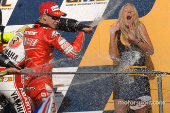 Podium: champagne for Casey Stoner