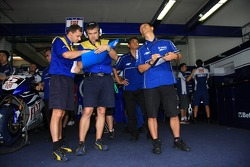 Michelin engineers inside the Fiat Yamaha Team garage