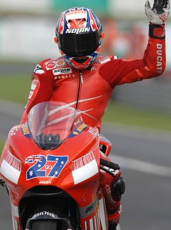 Race winner Casey Stoner celebrates