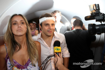 Felipe Massa with girlfriend Rafaela Bassi arrive at the party