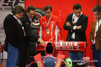 Tony Teixeira of A1GP and Richard Dorfman of A1GP take a look at a Ferrari F1 car