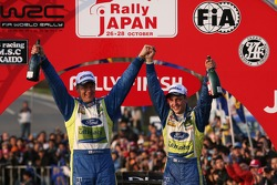 Podium: winners Mikko Hirvonen and Jarmo Lehtinen celebrates