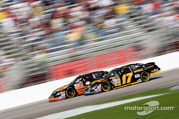 Matt Kenseth battles Martin Truex Jr. for the lead