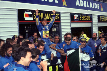 1994 Formula One World Champion Michael Schumacher celebrates with his team