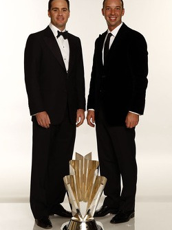 Jimmie Johnson and Chad Knaus pose with the NASCAR NEXTEL Cup Series championship trophy