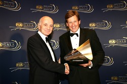 FIA Institute Deputy President Professor Gérard Saillant presents the 2007 FIA Institute Centre of Excellence trophy to Martin Whitaker, General Manager of the BIC on behalf of the Bahrain International Circuit