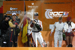 Michael Schumacher and Sebastian Vettel spray the champagne on the podium
