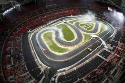 Final heat 3: Race of Champions winner Mattias Ekström completes his victory lap as Michael Schumacher climbs from his car