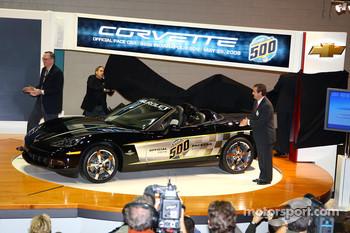 Chevrolet GM Ed Peper, left, and IMS President and COO Joie Chitwood, right, applaud the unveiling of the 30th anniversary commemorative edition Corvette Pace Car