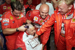 The Ferrari team celebrates the 2000 World Drivers Championship