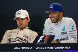 Second place Nico Rosberg, Mercedes AMG F1 with team mate, race winner and World Champion Lewis Hamilton, Mercedes AMG F1 in the FIA Press Conference