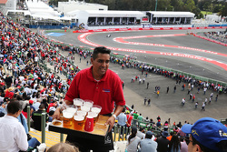 Fans in the grandstand served lager
