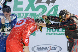 DP podium: champagne for Dario Franchitti and Juan Pablo Montoya