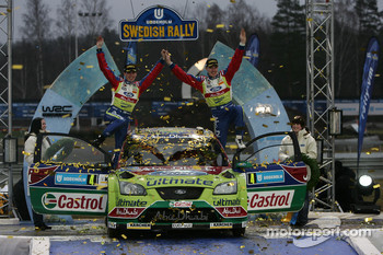 Podium: winners Jari-Matti Latvala and Miikka Anttila
