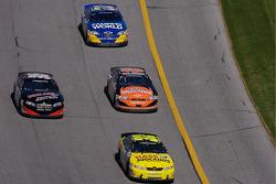 Denny Hamlin leads a group of cars