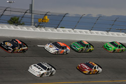 Johnny Sauter and Brad Keselowski lead a group of cars