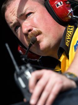 DeWalt Crew Chief, Chip Bolin, watches his car through the frontstretch