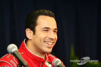 Helio Castroneves addresses the media