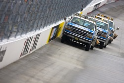 Trucks try to dry the track