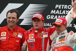 Podium: race winner Kimi Raikkonen, third place Heikki Kovalainen, Stefano Domenicali, Scuderia Ferrari, Sporting Director