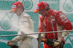 Podium: race winner Kimi Raikkonen, second place Robert Kubica