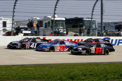 Race leader Kyle Busch emcounters a 3-wide battle as he looks for an opening to pass on the backstretch