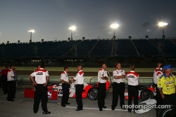Penske crew members watch qualifying