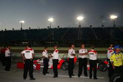 Penske crew members watch qualifying