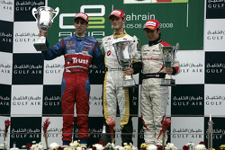 Romain Grosjean celebrates victory on the podium with Sebastien Buemi and Kamui Kobayashi