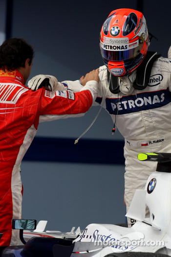 Race winner Felipe Massa celebrates with Robert Kubica