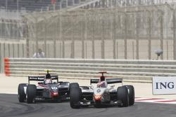Vitaly Petrov leads Kamui Kobayashi