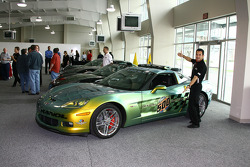 Two-time Indianapolis 500 winner Helio Castroneves shows off one of the Corvette Pace Cars for the 92nd running of