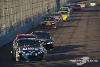Jimmie Johnson leads the field into turn one