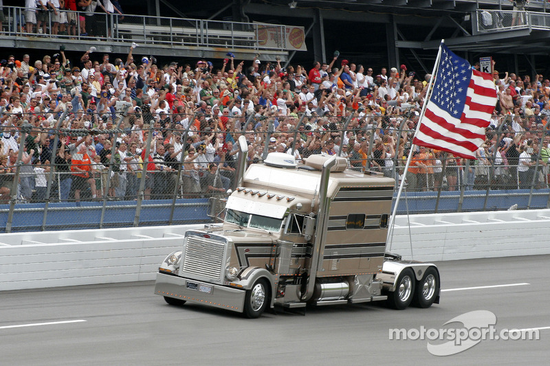 During The National Anthem A Nascar Semi Trailer Holds The American 2 on red semi truck