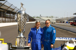Indy 500 Champions Al Unser Sr. and Al Unser Jr. pose with the Borg Warner trophy