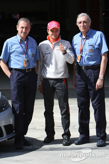 Heikki Kovalainen, McLaren Mercedes with FIA Medical Staff, Jacques Tropenat FIA, Medical Car Driver of Formula 1 and GP2 and Jean-Charles Piette, FIA Formula One Medical Delegate